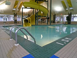 Indoor pool and hot tub with a slide  Canmore Hotels with Pools, Hot Tubs & Waterslides | Canmore Hotels